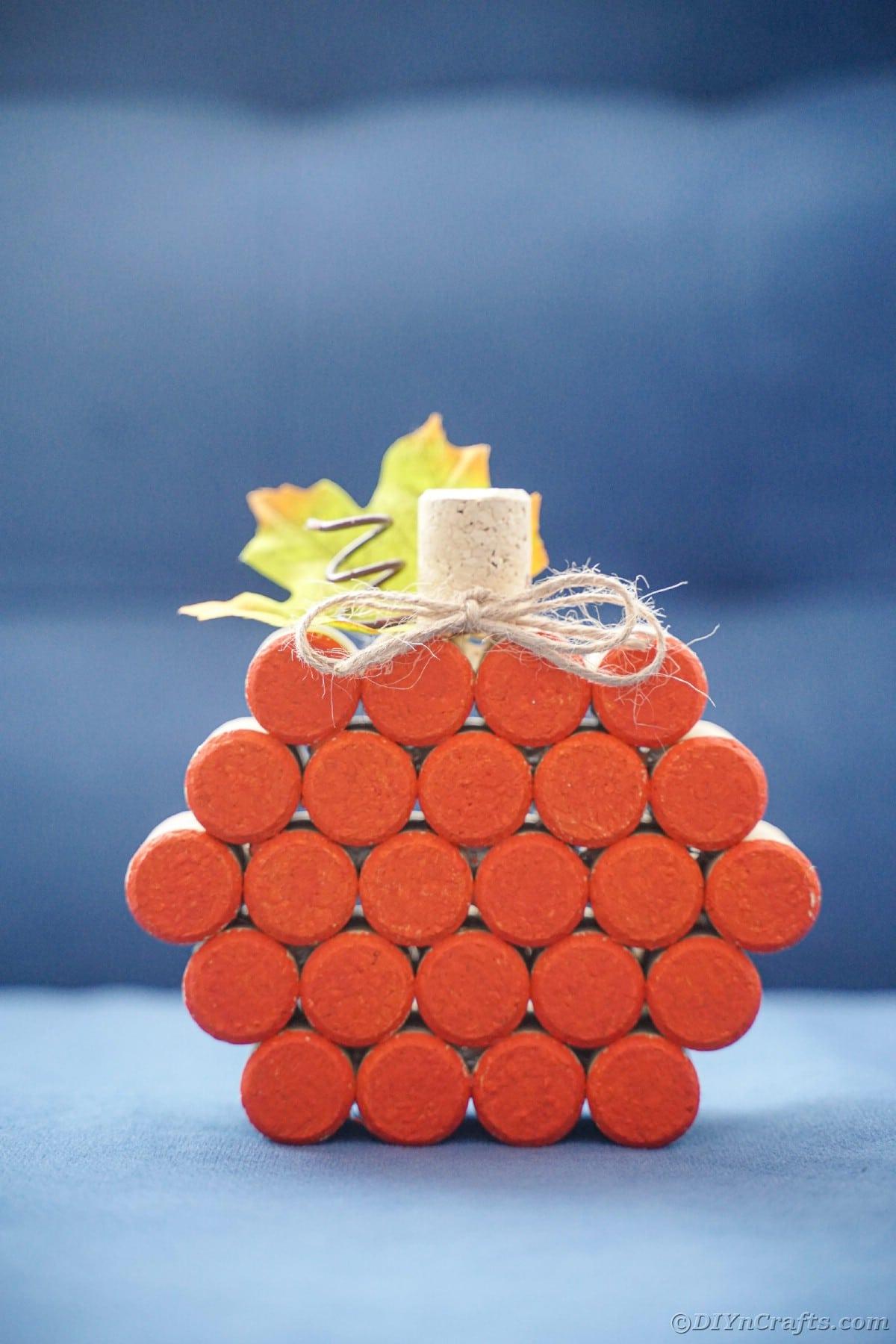 orange cork pumpkin on blue table