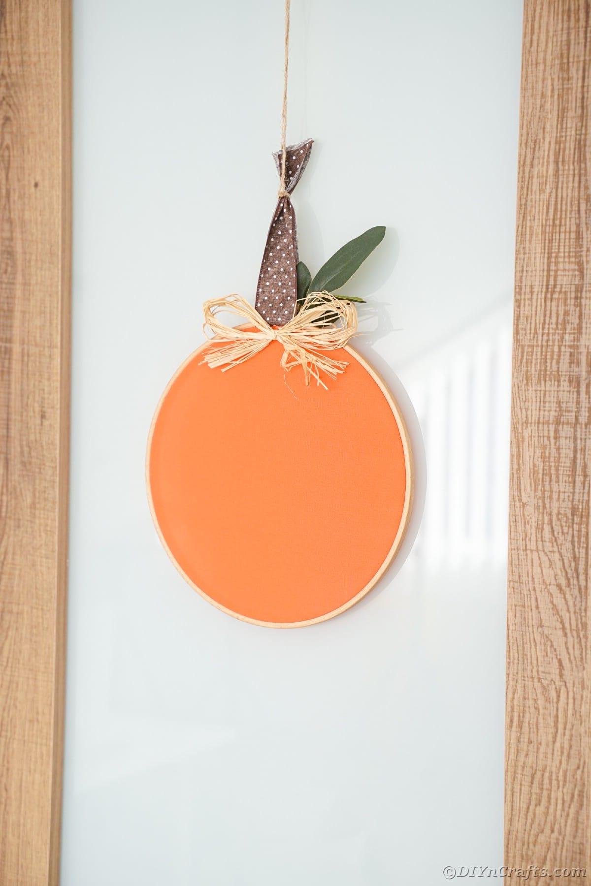 cloth pumpkin hung on the glass door