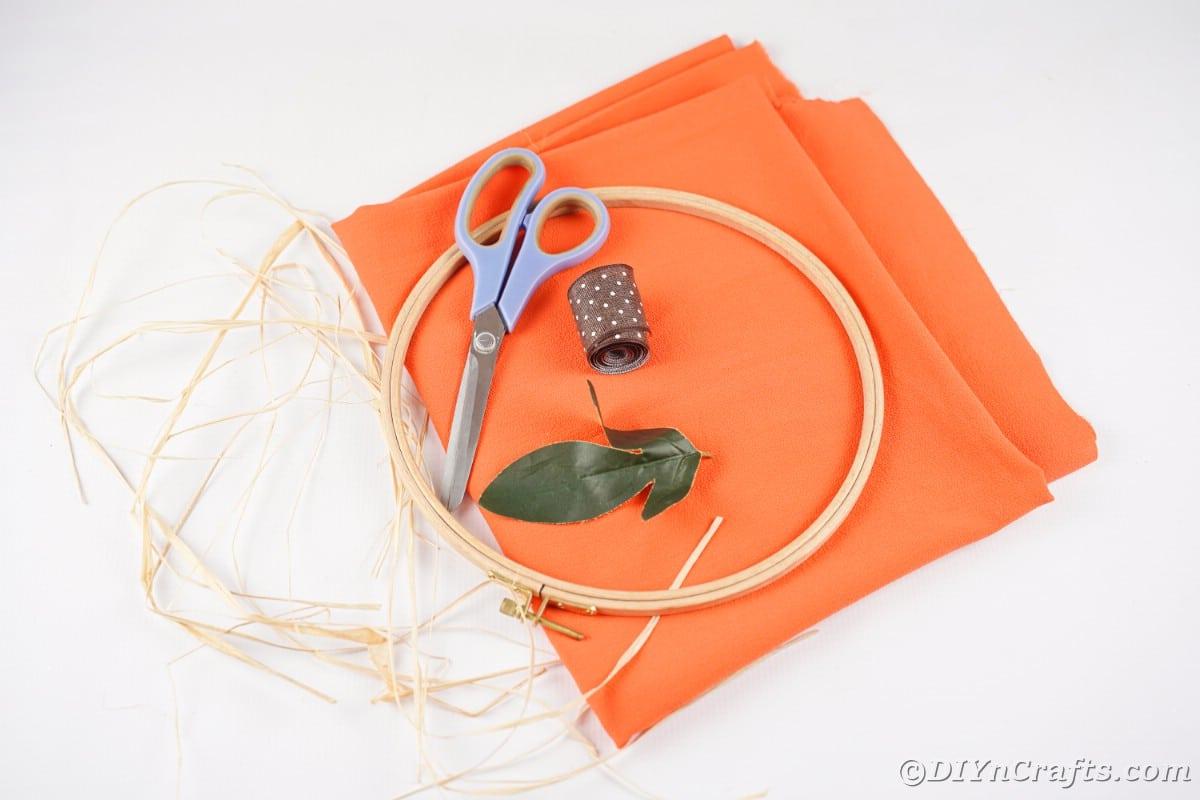 embroidery hoop raffia scissors and orange cloth n table