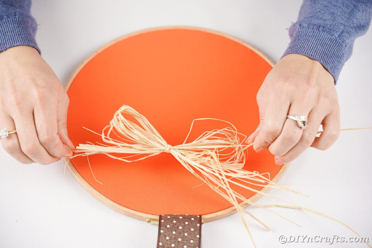 hand tied raffia to the bow