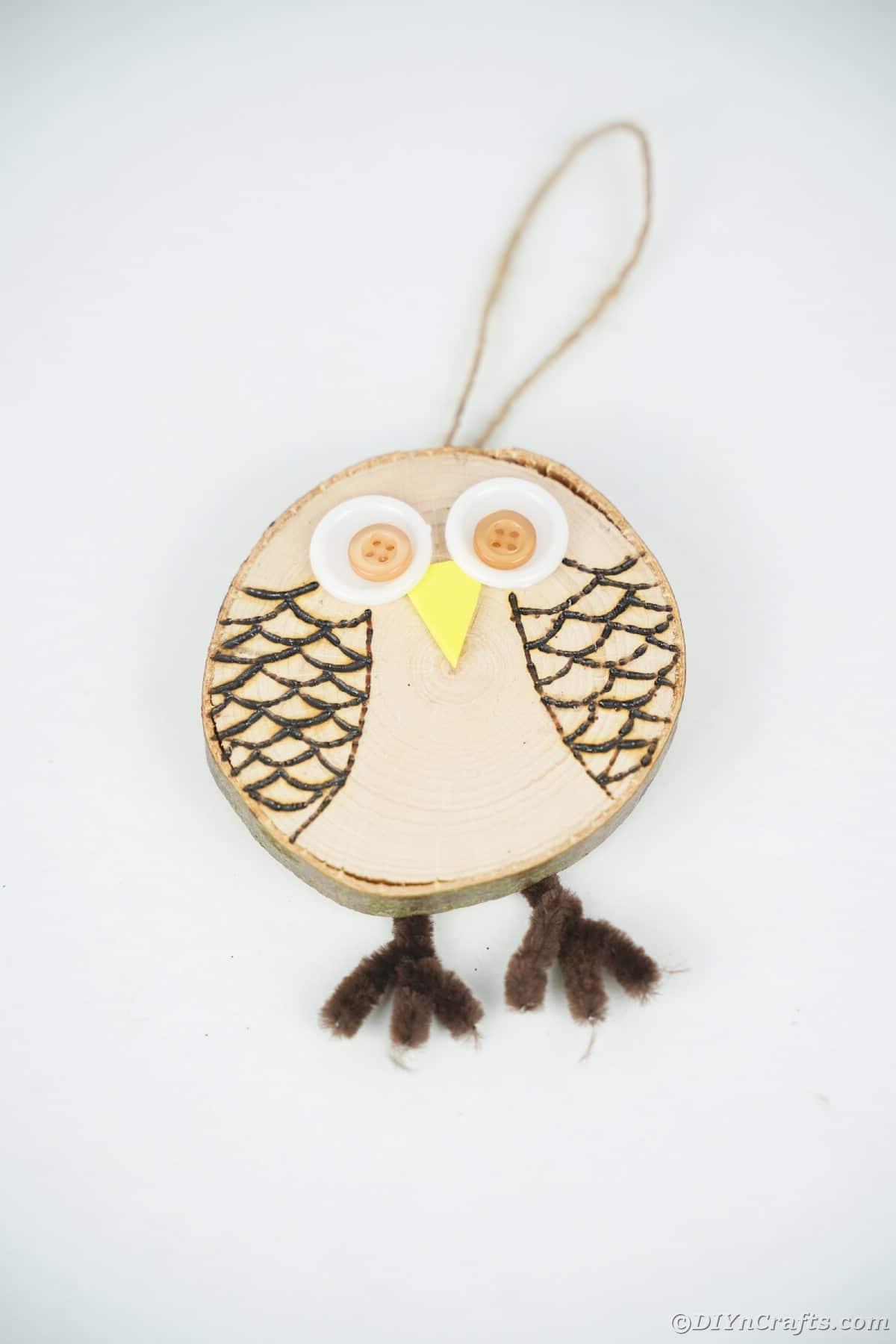 Wood slice owl on white table