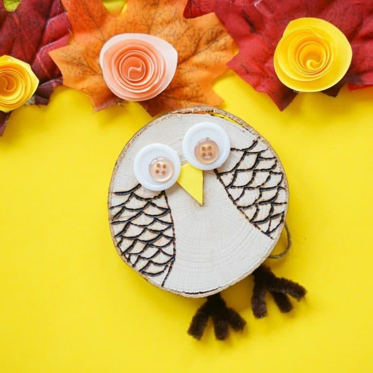 Wood slice owl on yellow paper mat