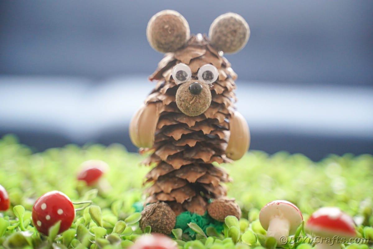 mini mushroom toys by pinecone bear on grass