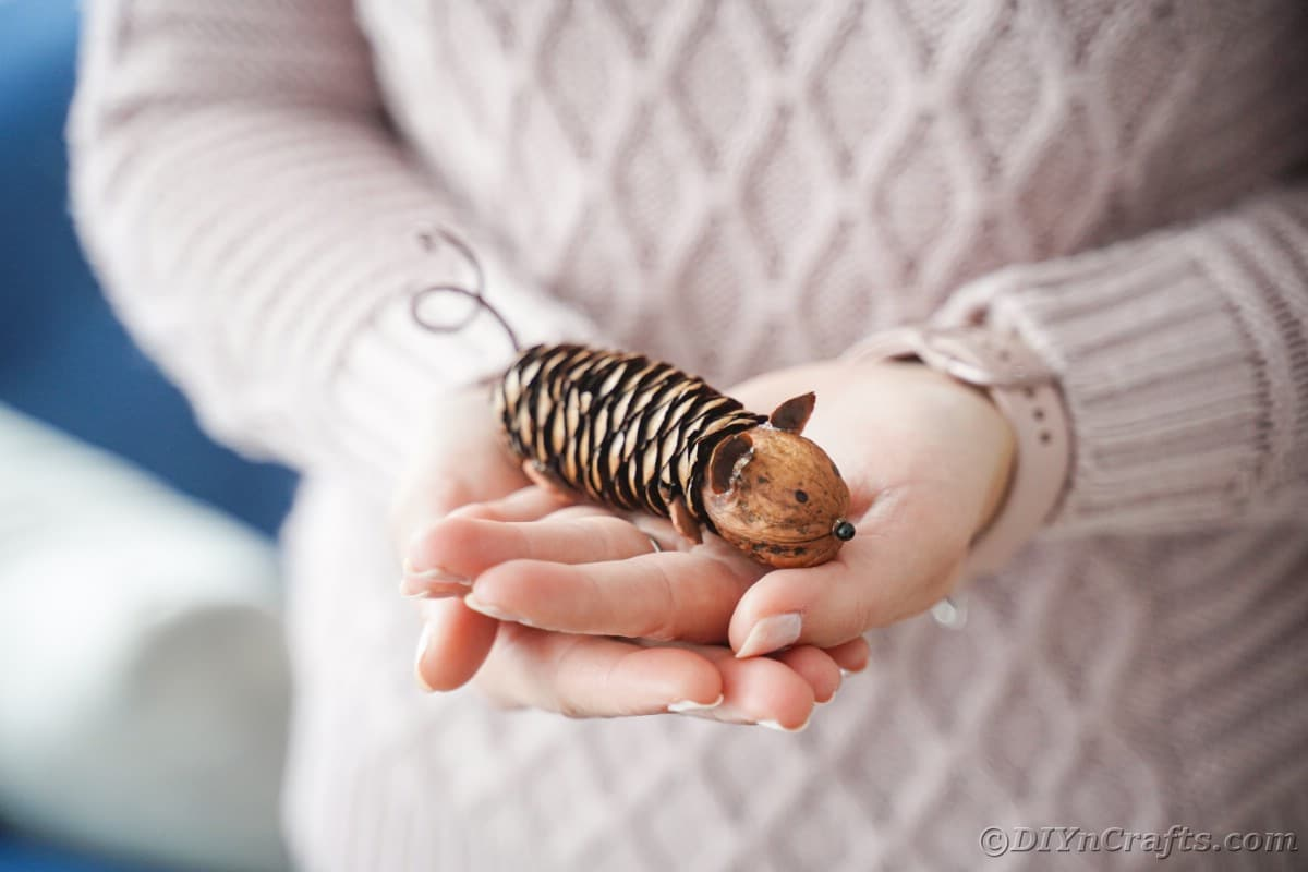 pinecone mouse held by woman