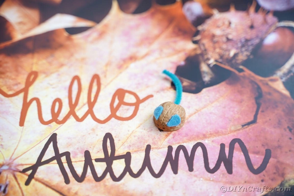 Hello autumn sign with fake mouse above message