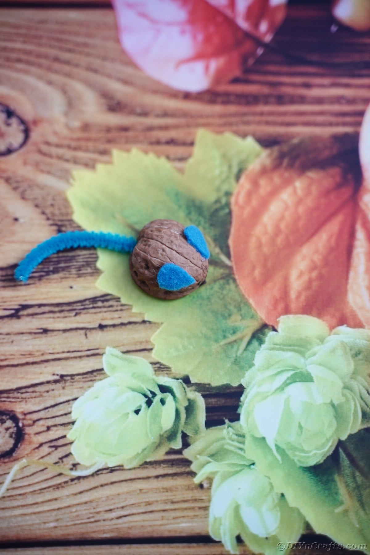 Walnut mouse on fall scrapbook paper
