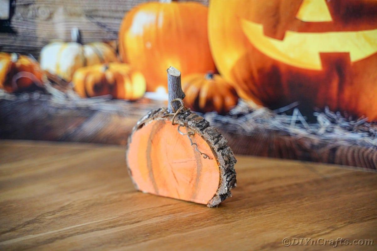 Wood mini pumpkin on table