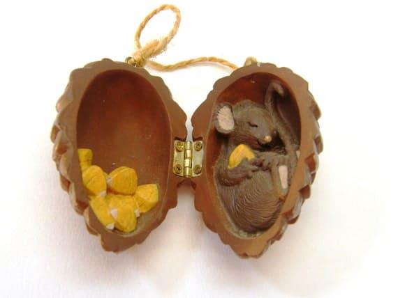 Mouse hibernating inside pinecone holiday ornament